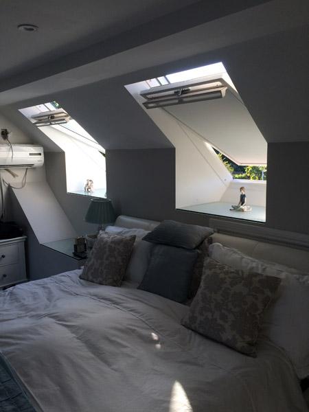 Loft conversion bedroom with velux windows in Littlehampton, Sussex